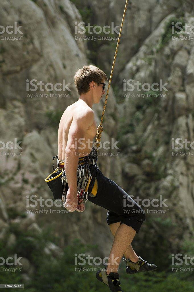 Young male climber coming down stock photo