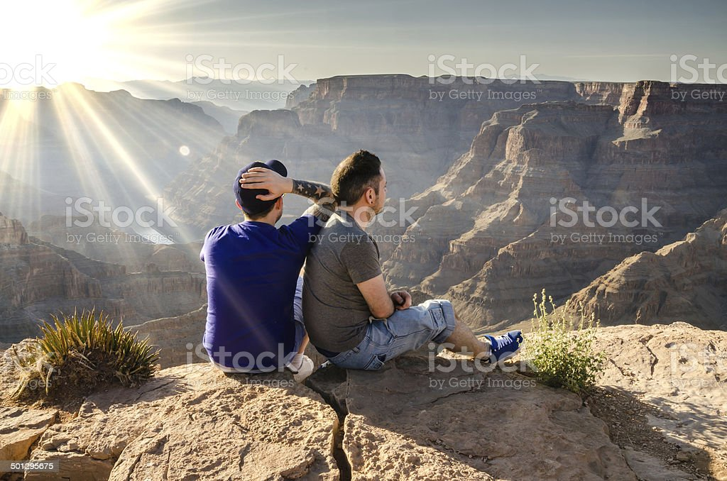Young Male Couple Looking Into Grand Canyon stock photo