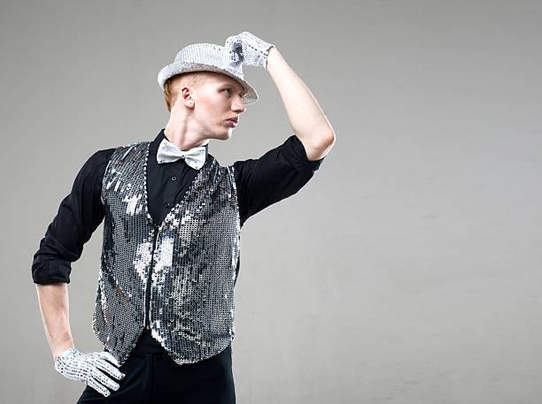 junge männliche tänzer in weste mit silber sparkles - pailletten shirt stock-fotos und bilder