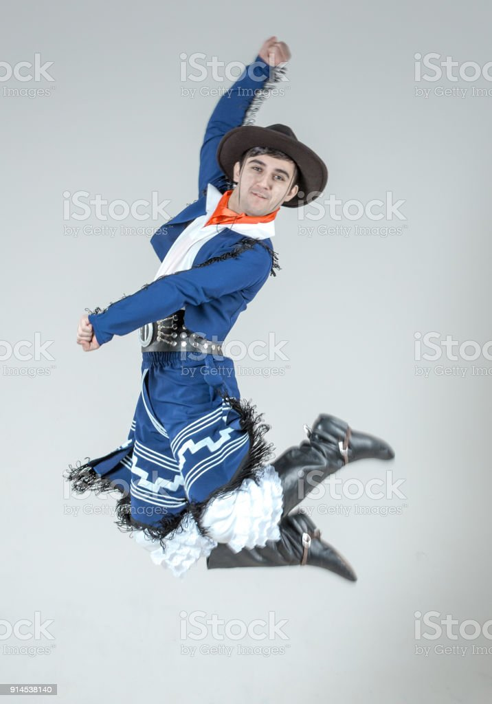 Young Male Dancer Is Jumping in Hispanic Dance stock photo