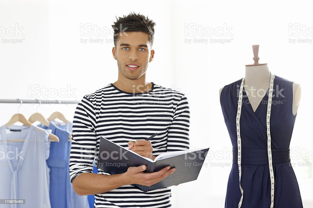 Young male designer working on fashion studio royalty-free stock photo