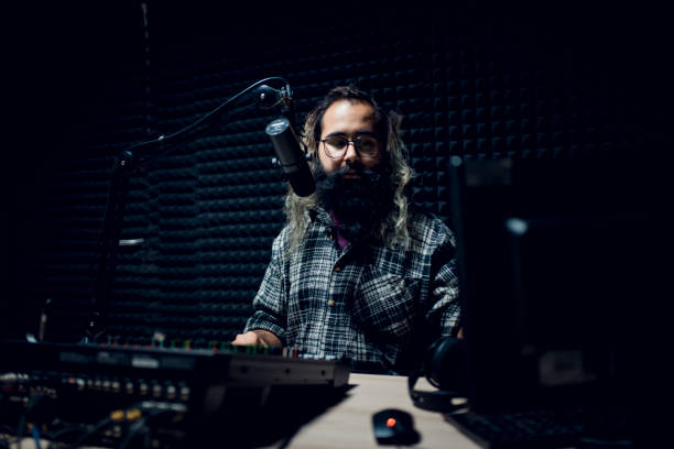 young male dj works in modern broadcasting studio - radio dj stock photos and pictures