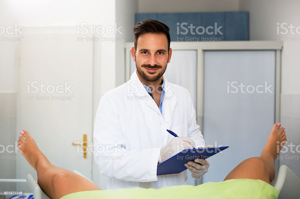 Young male doctor gynecologist check up his patient stock photo