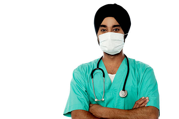 Young male doctor with face mask stock photo