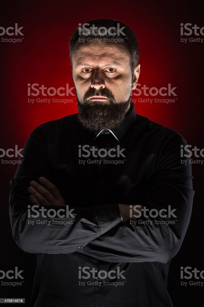 Young male dressed and posing like an evil magician stock photo