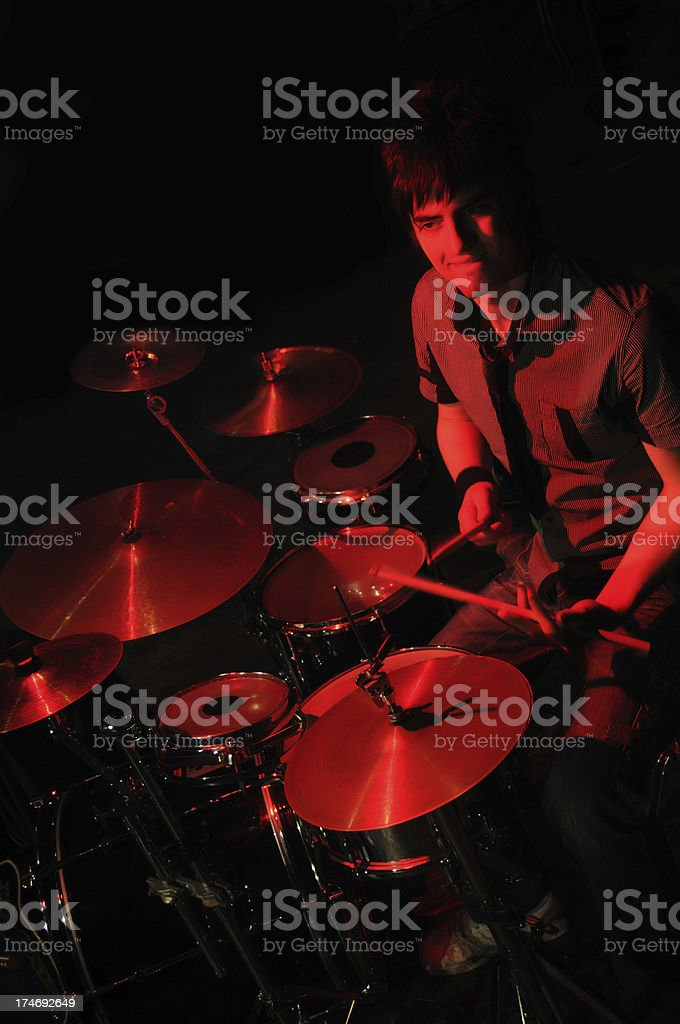 Young Male Drummer Playing Drums stock photo