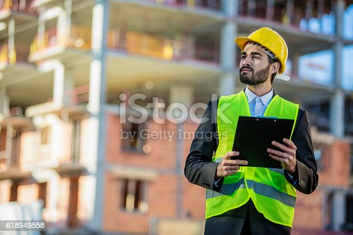 617878058 istock photo Young male engineer at a construction site 618949558