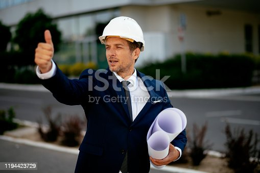 617878058 istock photo Young male engineer at a construction site stock photo 1194423729