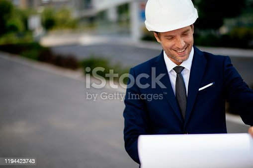 617878058 istock photo Young male engineer at a construction site stock photo 1194423743