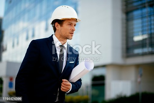 617878058 istock photo Young male engineer at a construction site stock photo 1194424399