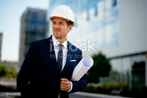 617878058 istock photo Young male engineer at a construction site stock photo 1194424440