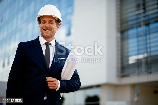 617878058 istock photo Young male engineer at a construction site stock photo 1194424533