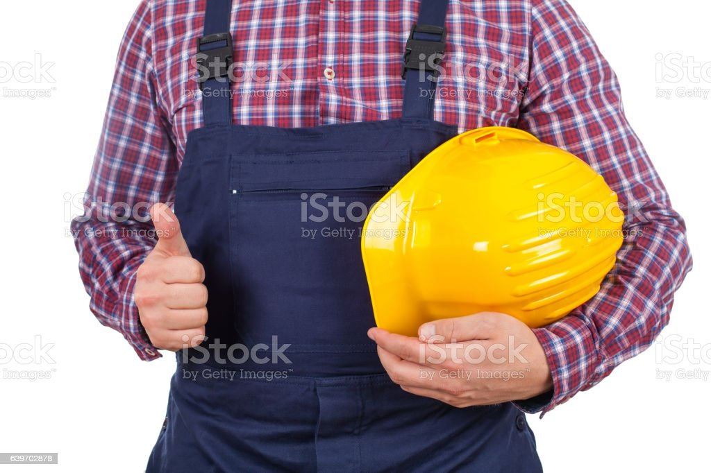 Young male engineer holding his helmet stock photo