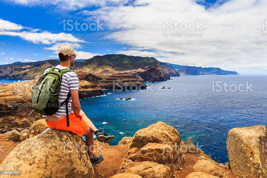 Young male enjoying the view at Ponta de Sao Lourenco stock photo