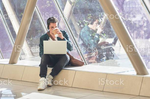 Young male entrepeneur student waiting working on laptop in sunny picture id841181884?b=1&k=6&m=841181884&s=612x612&h=cxjlyy4ngjiugalmq pfqqd3xct7b9v7qfvaiku qdk=