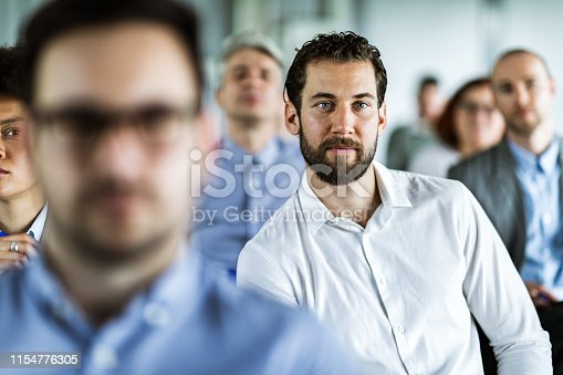 istock Young male entrepreneur attending a seminar with his colleagues. 1154776305