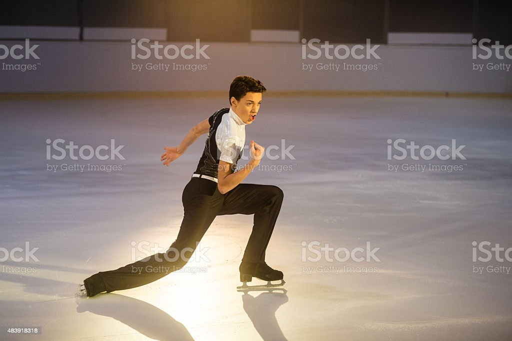 Young male figure skater performing stock photo