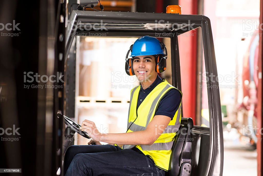 young male forklift driver in a warehouse stock photo