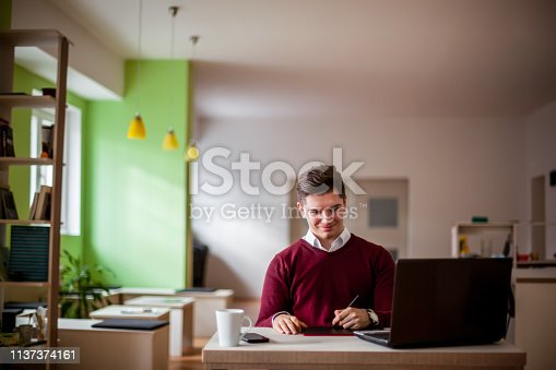932763106 istock photo Young male freelancer 1137374161