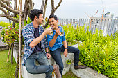 istock Young Male Friends Having Drinks at a Rooftop Party 802318356