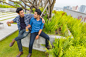 istock Young Male Friends Having Drinks at a Rooftop Party 802318368