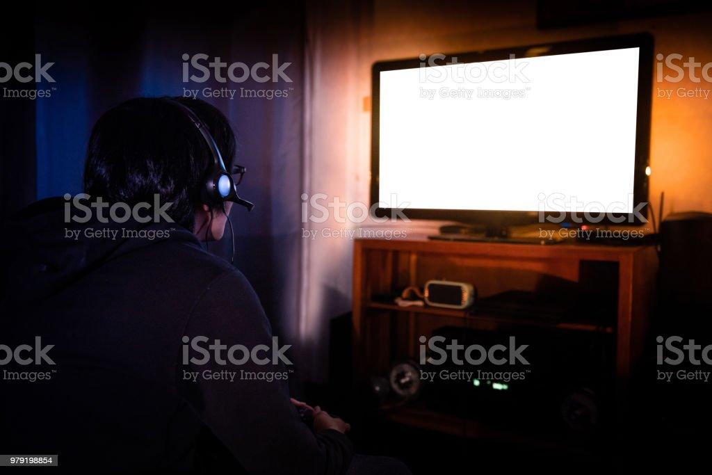Fotografía de Joven Jugador Con Gafas Y Auriculares Jugando Video ...