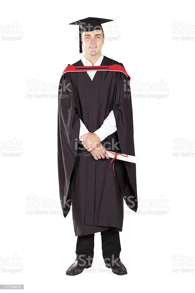 05a51b8b2 Joven hombre y tapa de graduación graduado en traje de cuerpo completo foto  de stock libre
