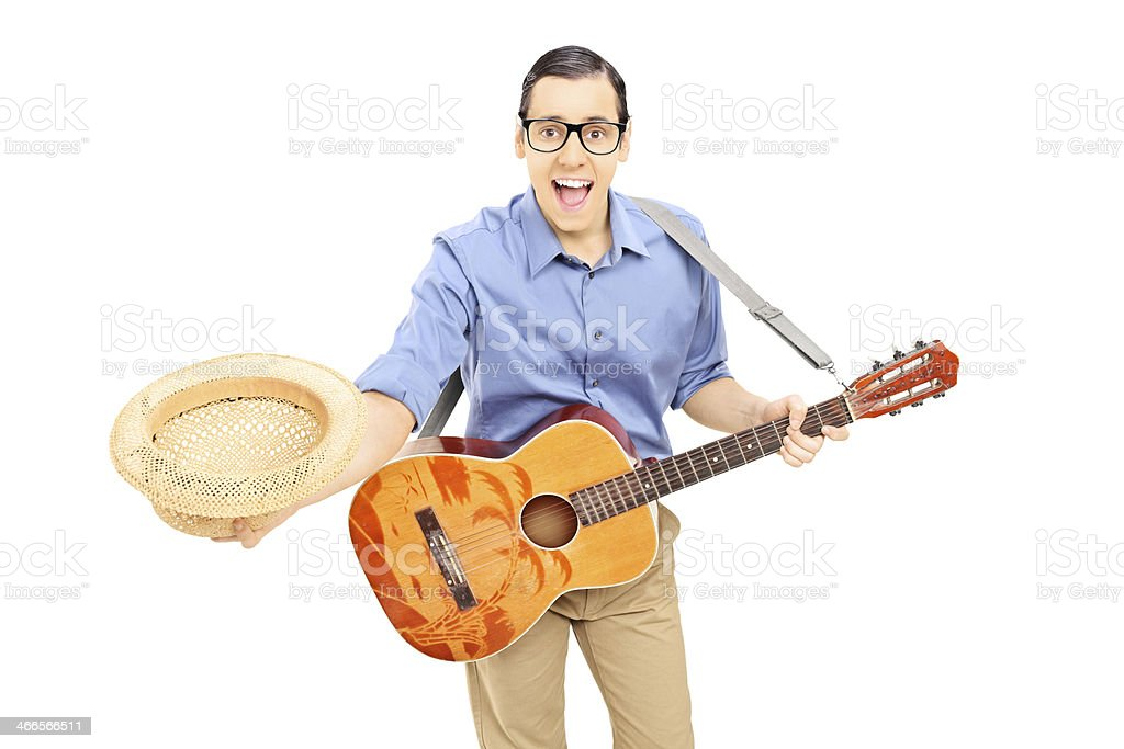 Young male guitarist bow down holding his hat stock photo
