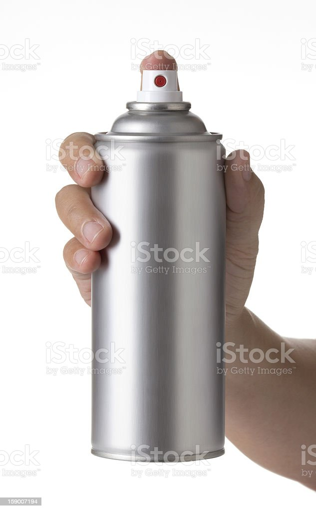 young male hand spraying an Metal aerosol can stock photo