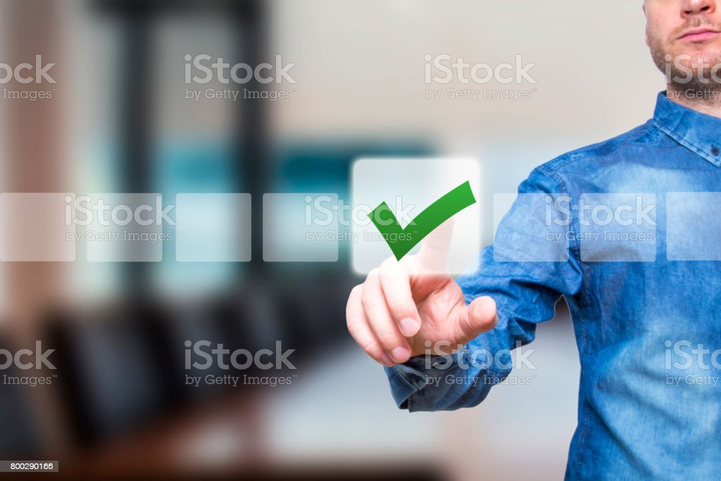 Young male hand touching, pressing modern button and ticking check box out of empty boxes on digital screen interface. Isolated on office Business technology concept. Stock Image stock photo