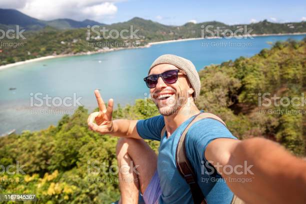 Young male hipster traveler doing selfie overlooking the tropical sea picture id1167945367?b=1&k=6&m=1167945367&s=612x612&h= hop vhubq3jrhx4zomgrisz3z1zzahgdgq87kjkcw4=