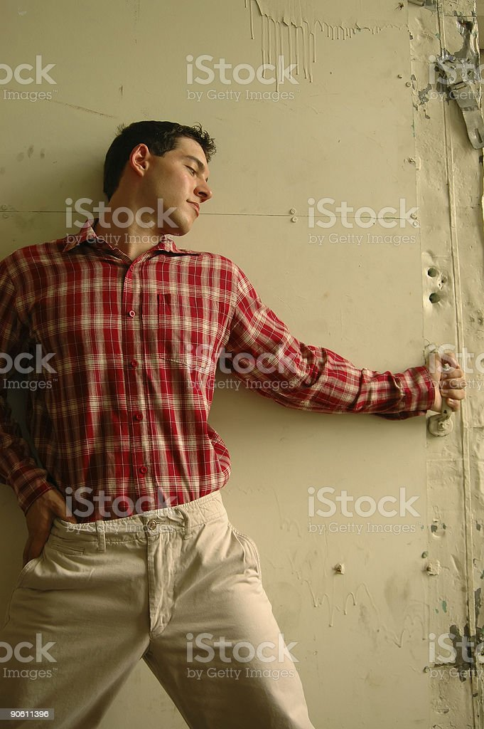 young male in red plaid shirt stock photo