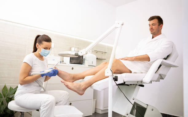 Young male in spa salon on pedicure treatment Young male in spa salon on pedicure treatment. Man  in bathrobe on full spa day. Body care. Healthy care. pedicure manicure men beauty spa stock pictures, royalty-free photos & images