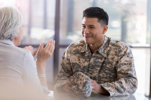 Young male in uniform smiles at counselor picture id1087566184?b=1&k=6&m=1087566184&s=612x612&w=0&h=zoq24h0y jshha5qnmgfobkkqvdfoak5lmhnlrkcado=