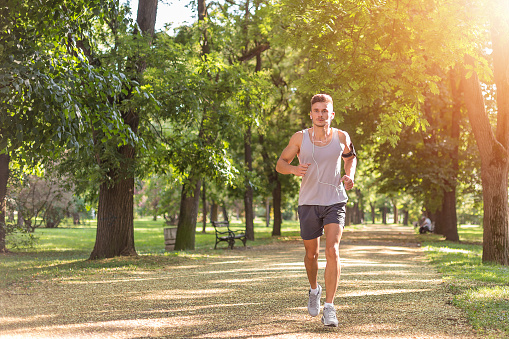 Young male jogging in the park