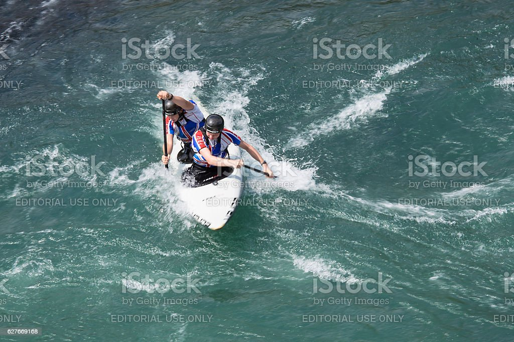 Young Male Kayakers at Slalom Race at Soča river stock photo