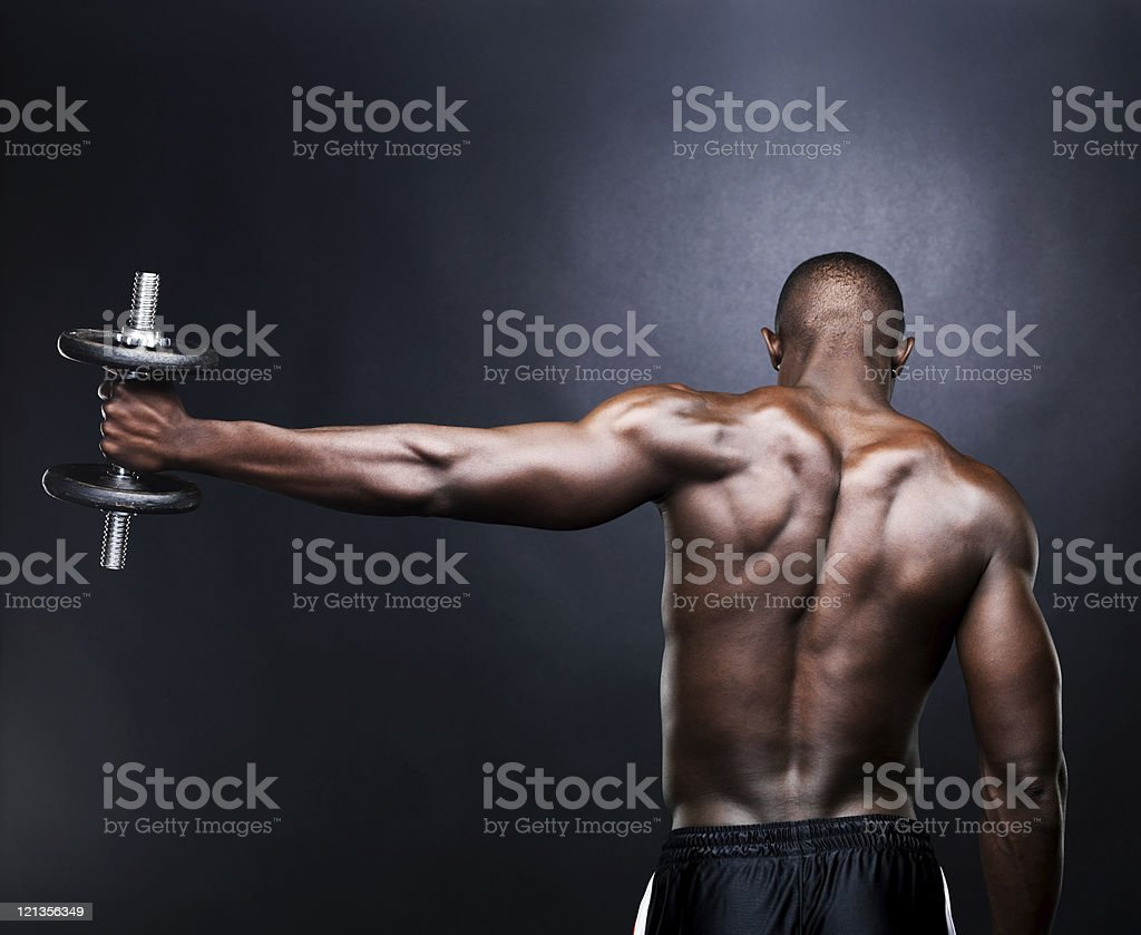 Young, male lifting dumbbell stock photo