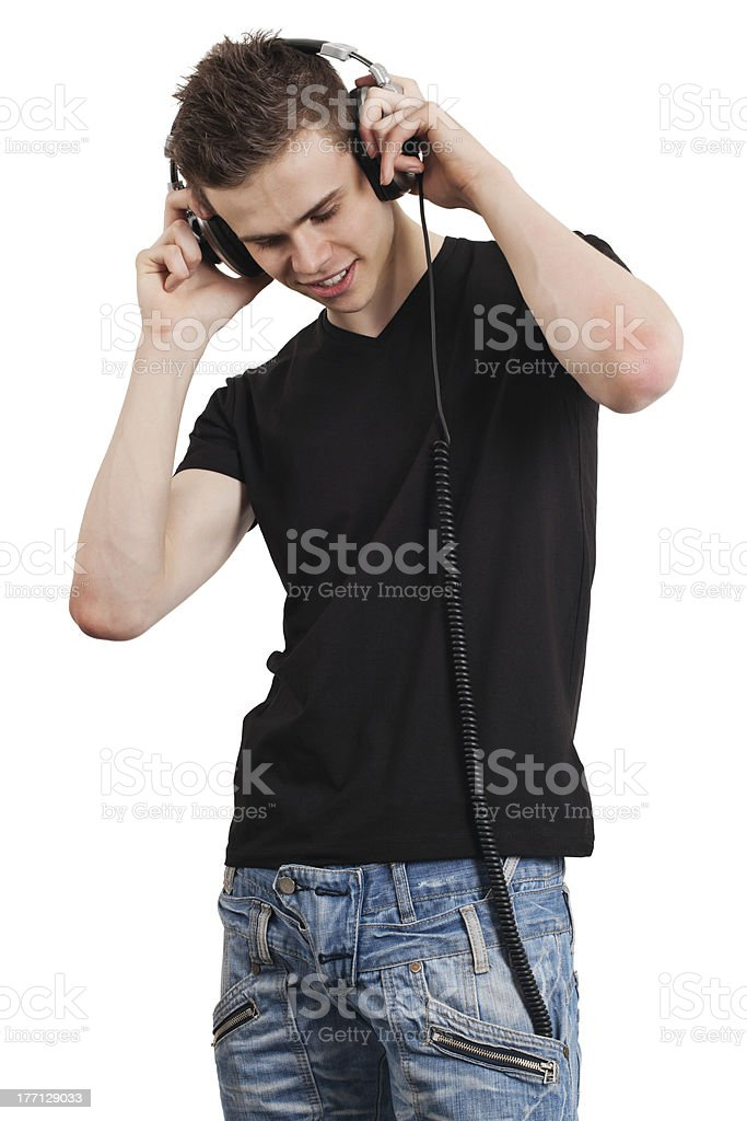Young male listening to headphones stock photo
