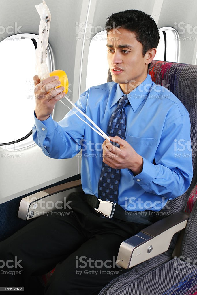 Young male looking concerned at the oxygen mask stock photo