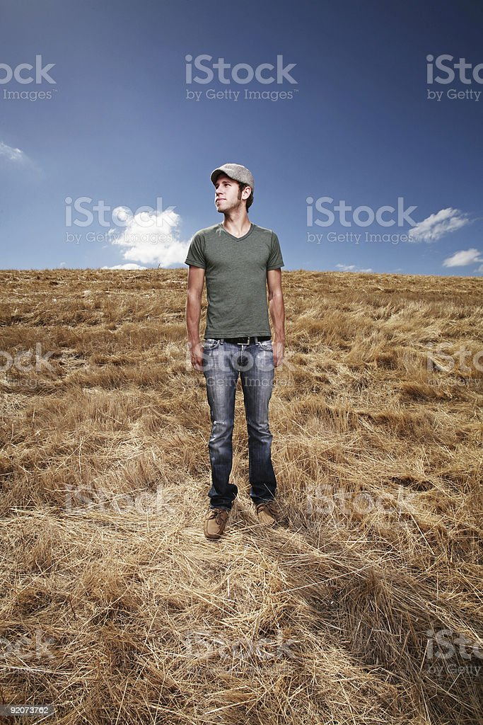 Young Male Looking into the Distance of a Field royalty-free stock photo