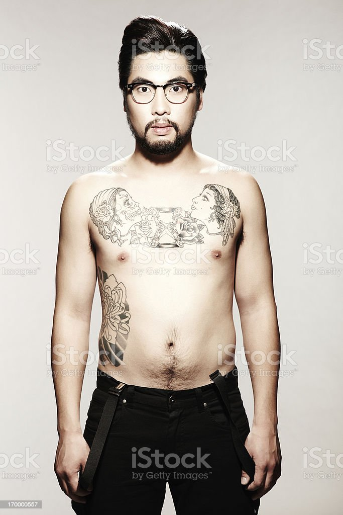 Young Male Model with Tattoo and Glasses stock photo