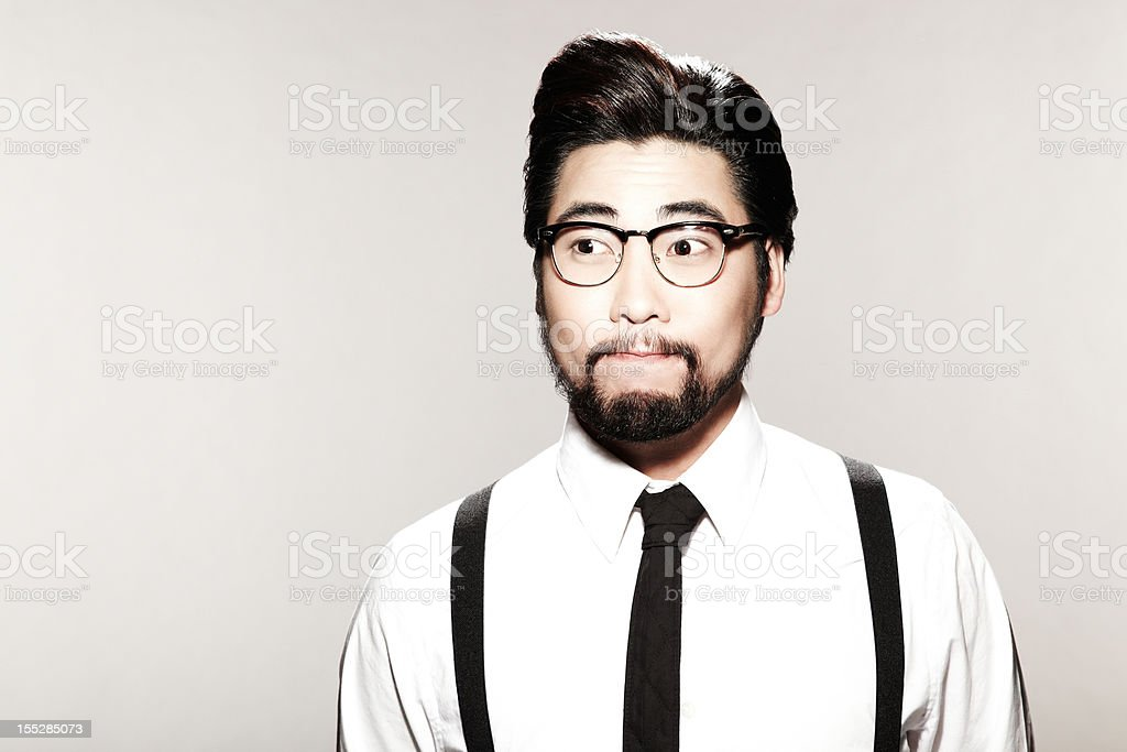 Young Male Model With Tie and Suspenders stock photo