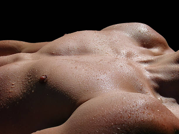 young male muscular body with water drops stock photo
