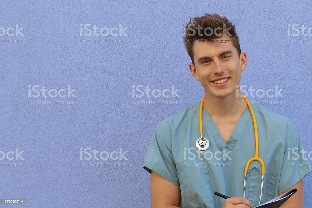 Young male nurse with a clipboard stock photo