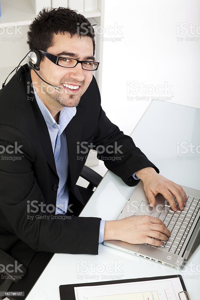 Young male operator working in office royalty-free stock photo