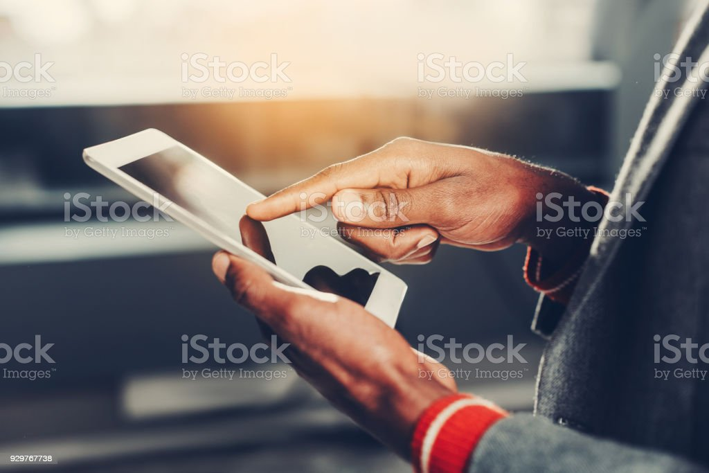 Young male person using device stock photo