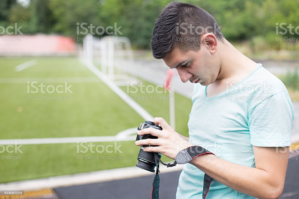 Young male photographer stock photo