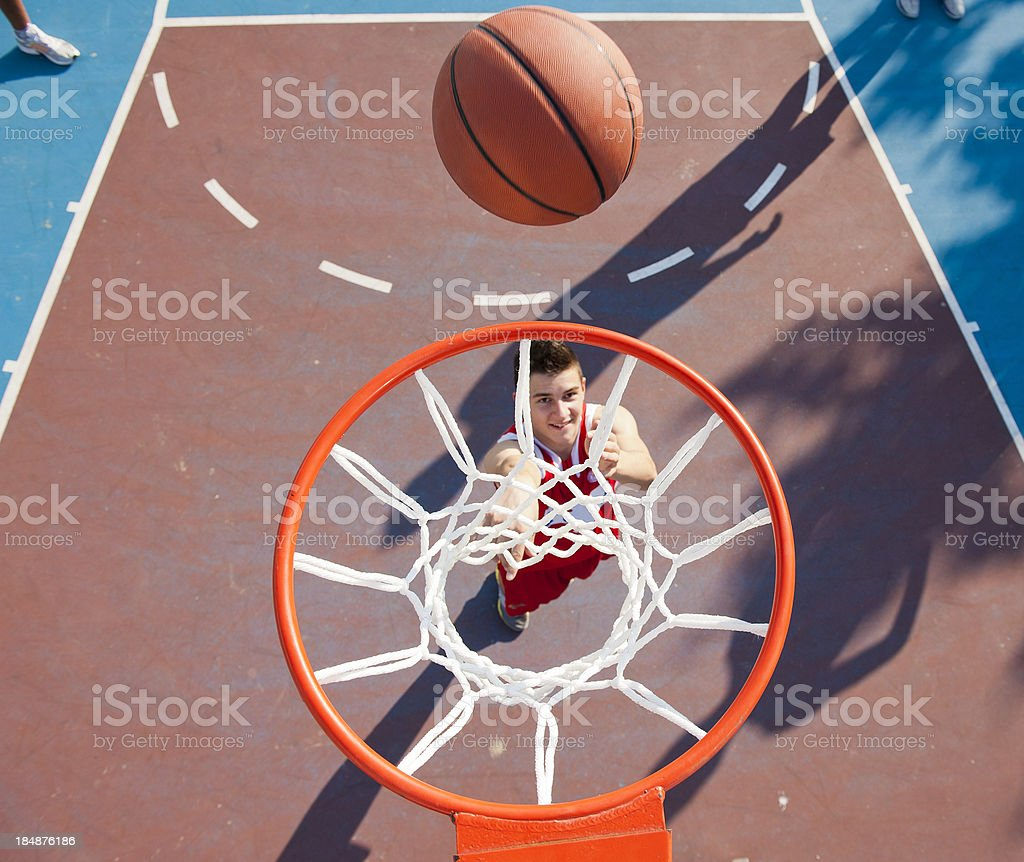 Young male player making basket stock photo