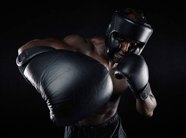 Young male practicing boxing stock photo
