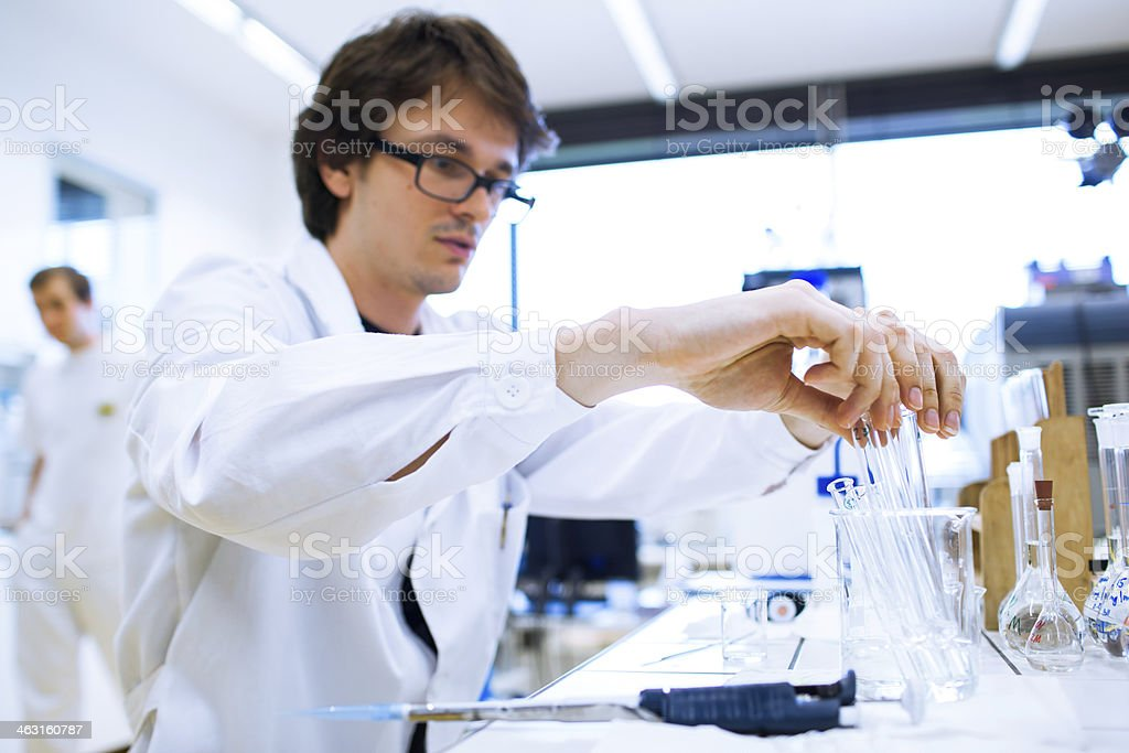 Young male researcher carrying out scientific research in a lab - Royalty-free Adult Stock Photo